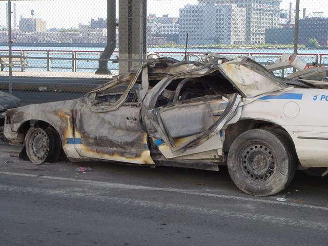 Peculiar wilting of car doors and deformed  window on FDR Drive... half a mile away from the WTC!! - drjudywood.com